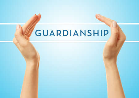 guardianship: Female hands with word guardianship on blue background Stock Photo