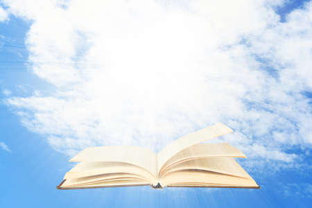 opened book: Opened book on sky background Stock Photo