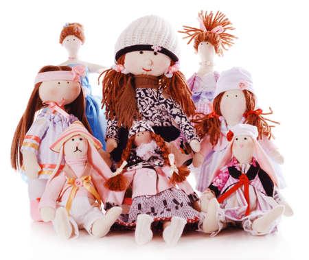 Handmade dolls isolated on white photo