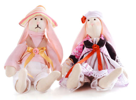 Handmade dolls isolated on white photo