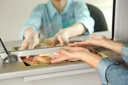 Teller window with working cashier. Currency exchange concept Stockfoto