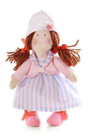 Handmade doll isolated on white photo