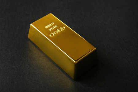 Gold bar on black background