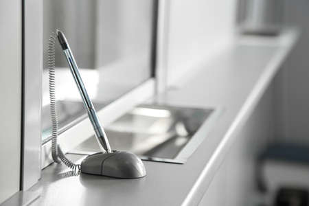 Pen on surface near cash department window
