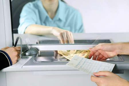 Teller window with working cashier