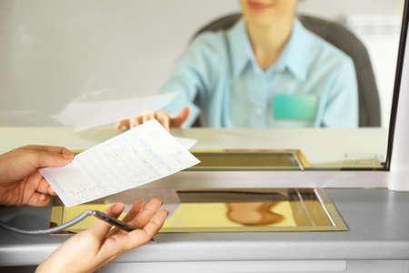 teller: Teller window with working cashier