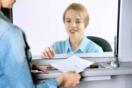 Teller window with working cashier. Concept of payment of utilities Stock Photo