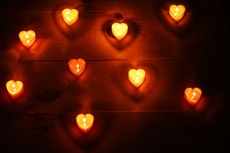 an atmosphere: Romantic atmosphere with candle lights on dark background