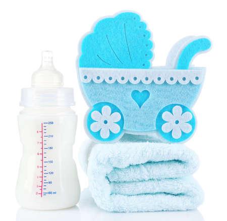 infantile: Blue little pram and bottle of milk isolated on white Stock Photo