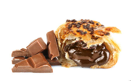 chunks: Fresh and tasty croissant with chocolate chunks, isolated on white Stock Photo