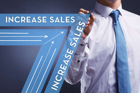 increase sales: Increase sales concept. businessman drawing on screen