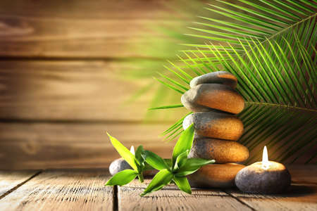 Spa stones, candle on wooden background Stock Photo