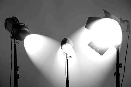lighting background: Photo studio with lighting equipment on grey wall background Stock Photo