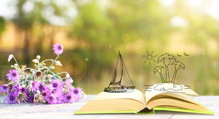 adventure story: Open book with drawings on nature background
