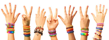 bangles hand: Female hands with bracelets isolated on white