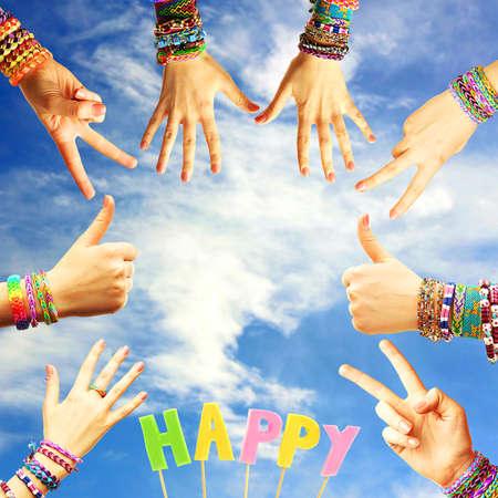 bangles hand: Female hands with bracelets on sky background