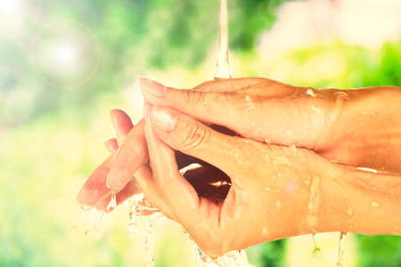 women subtle: Washing hands on nature background