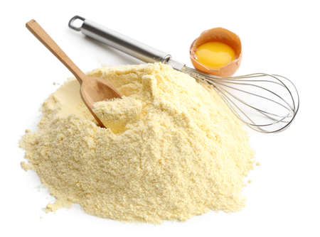 corolla: Heap of cornmeal with egg and corolla isolated on white