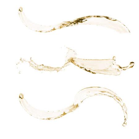 spewing: Wine splashes isolated on white
