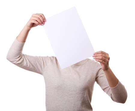 hoja en blanco: Woman covering her face with blank sheet of paper isolated on white