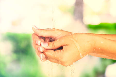 women subtle: Washing hands on nature