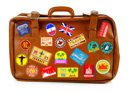 holiday destinations: Travel suitcase isolated on white Stock Photo