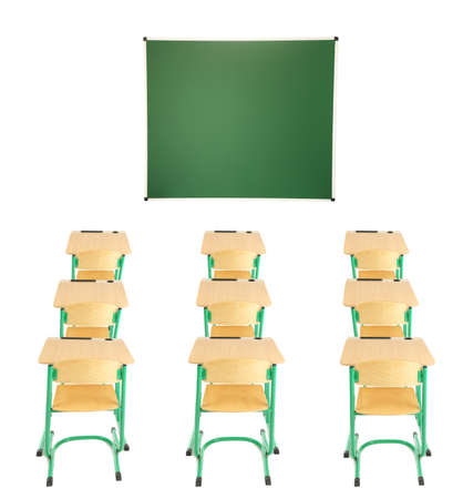 schooldesk: School blackboard, wooden desks and chairs isolated on white