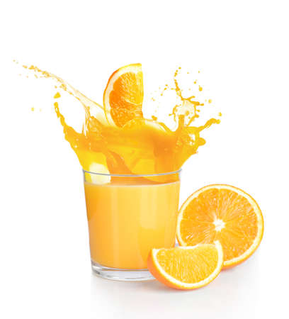 Orange juice splashes isolated on white Foto de archivo