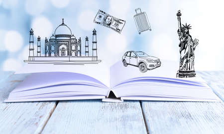 adventure story: Open book with drawings on light