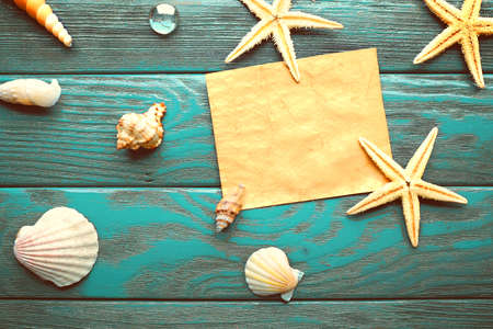 sea stars: Card blank with sea stars and shells on wooden  Stock Photo