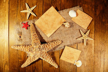 blanks: Card blanks with sea stars and shells on wooden background Stock Photo