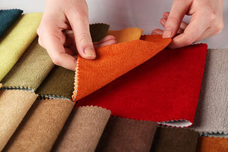 table scraps: Woman chooses scraps of colored tissue on table close up