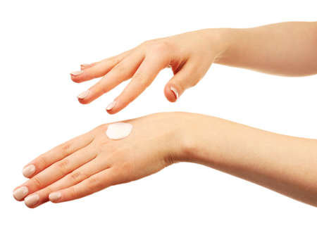 caring hands: Woman caring hands with cream isolated on white