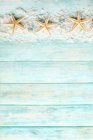 sea: Sea stars on sea salt on wooden background