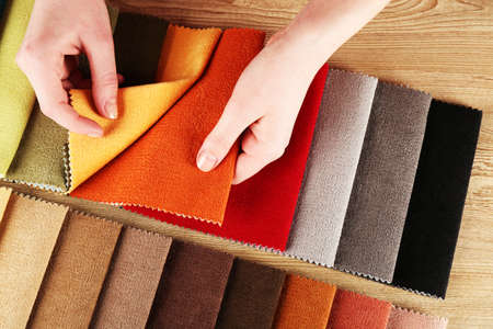 scraps: Woman chooses scraps of colored tissue on table close up