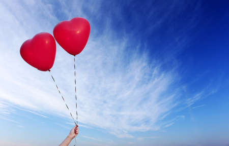 balloons: Love heart balloons on sky background Stock Photo