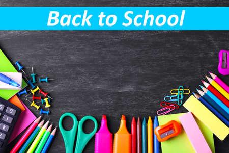 secondary school students: School supplies on blackboard background