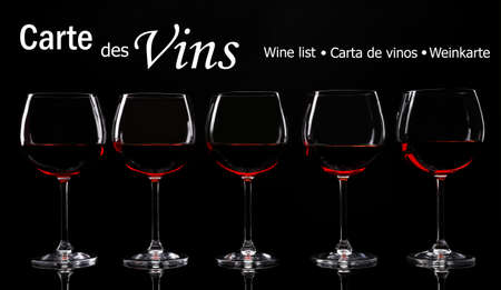 vins: Glasses with red wine on black background