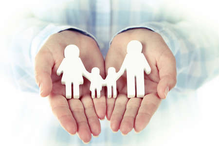 holding mother's hand: Female hands holding toy family, closeup