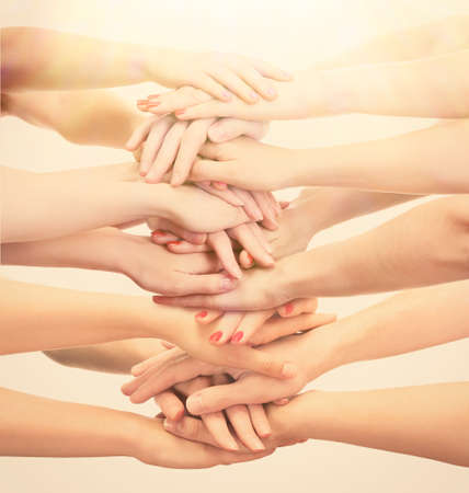 join the team: Young peoples hands, close up Stock Photo