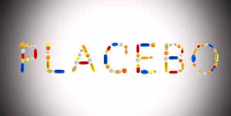 placebo: The word Placebo made with pills on color background Stock Photo