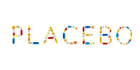 placebo: The word Placebo made with pills isolated on white