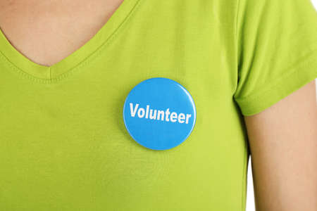 Round volunteer button on shirt of girl