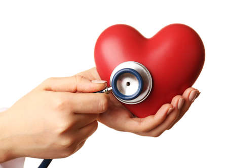 Doctor hands with heart and stethoscope isolated on white