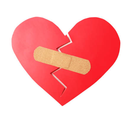 heart pain: Broken heart with plaster isolated on white Stock Photo
