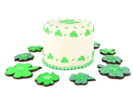 three leaved: Delicious cake and cookies for Saint Patricks Day isolated on white Stock Photo