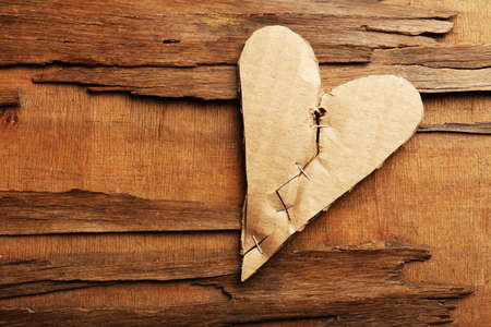mended: Broken heart on rustic wooden table