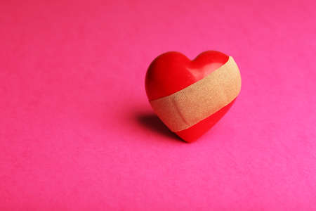 mended: Heart with plaster on colorful