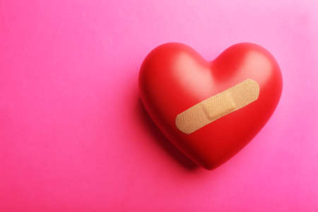 mended: Heart with plaster on colorful background