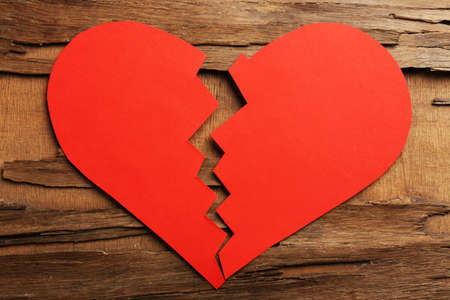 mended: Broken heart on rustic wooden table background